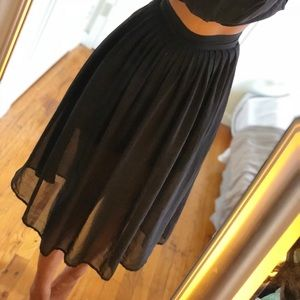 Midi length black pleated skirt
